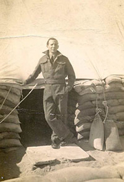 soldier standing outside his well sandbagged home